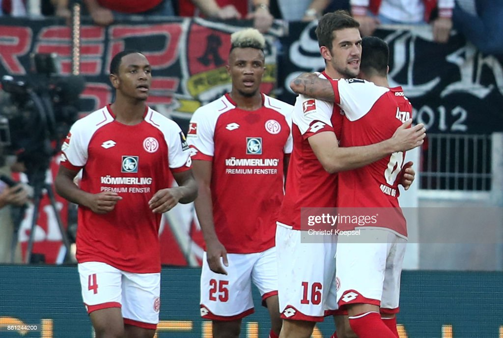 Stefan Bell of Mainz (2nd R) celebrates the second goal with his team mates during the Bundesliga match between 1. FSV Mainz 05 and Hamburger SV at Opel Arena on October 14, 2017 in Mainz, Germany.