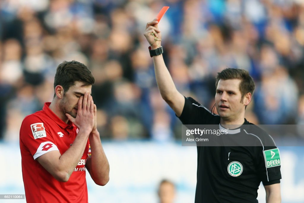 Stefan Bell of Mainz is sent odff by referee Frank Willenborg during the Bundesliga match between SV Darmstadt 98 and 1. FSV Mainz 05 at Jonathan-Heimes-Stadion am Boellenfalltor on March 11, 2017 in Darmstadt, Germany.