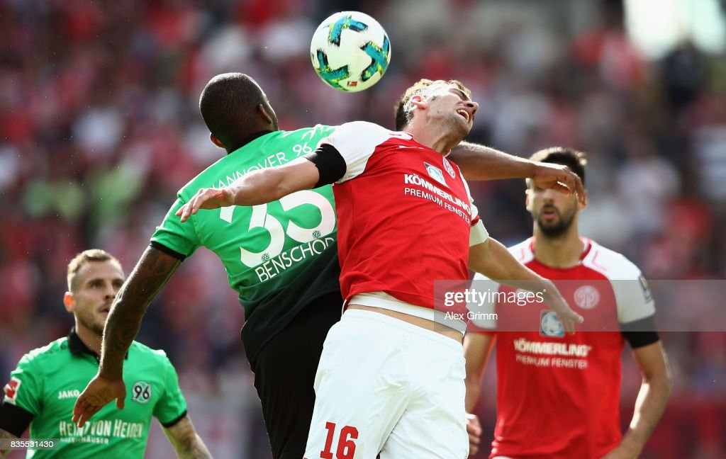 Stefan Bell of Mainz jumps for a header with Charlison Benschop of Hannover during the Bundesliga match between 1. FSV Mainz 05 and Hannover 96 at Opel Arena on August 19, 2017 in Mainz, Germany.