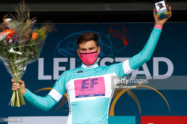 Stefan Bissegger of Switzerland and Team EF Education - Nippo celebrates winning the Turquoise Points Jersey on the podium ceremony after the 17th...