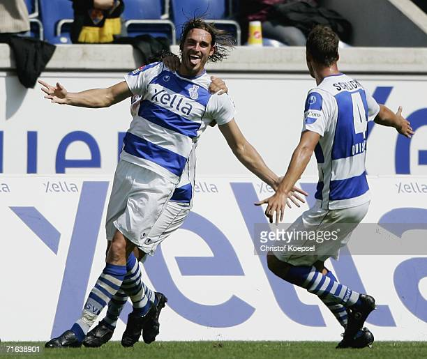 Stefan Blank of Duisburg celebrates the second goal with Youssef Mokhtari and Bjorn Schlicke during the Second Bundesliga match between MSV Duisburg...