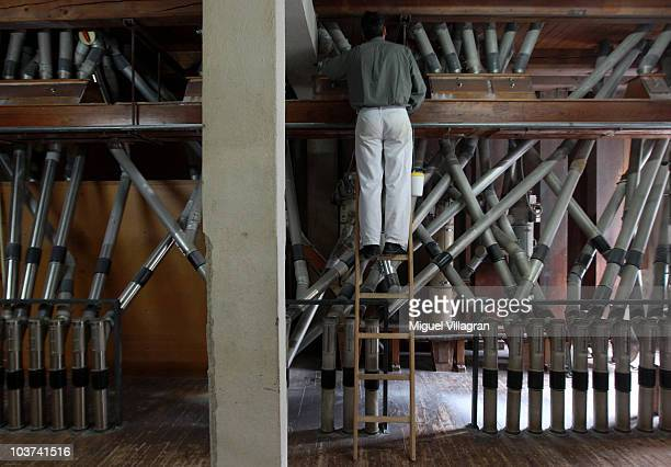 Stefan Blum changes the distribution ways of the pipe system of a milling machine that produces flour at the Hofbraeuhaus Kunstmühle mill on August...