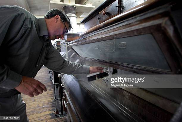 Stefan Blum cleans the engine at the Hofbraeuhaus Kunstmühle mill on August 30 2010 in Munich Germany Fires in Russia and a lowerthanexpected crop in...
