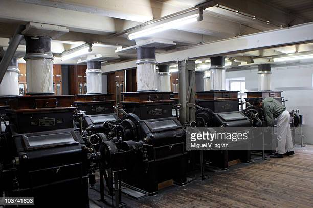 Stefan Blum cleans the engines at the Hofbraeuhaus Kunstmühle mill on August 30 2010 in Munich Germany Fires in Russia and a lowerthanexpected crop...