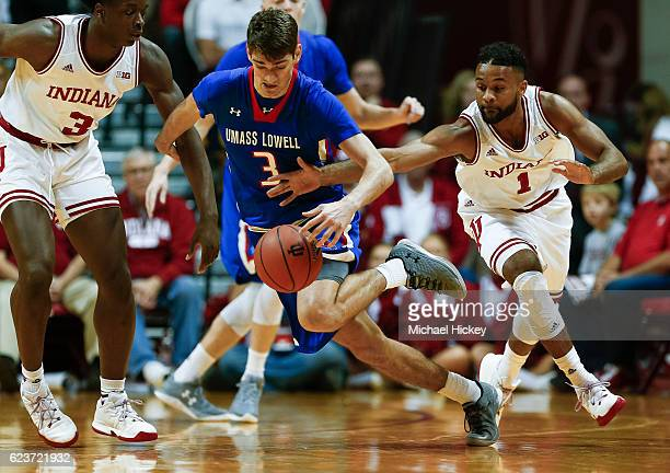 Stefan Borovac of the UMass Lowell River Hawks dribbles the ball as James Blackmon Jr. #1 of the Indiana Hoosiers reaches at Assembly Hall on...