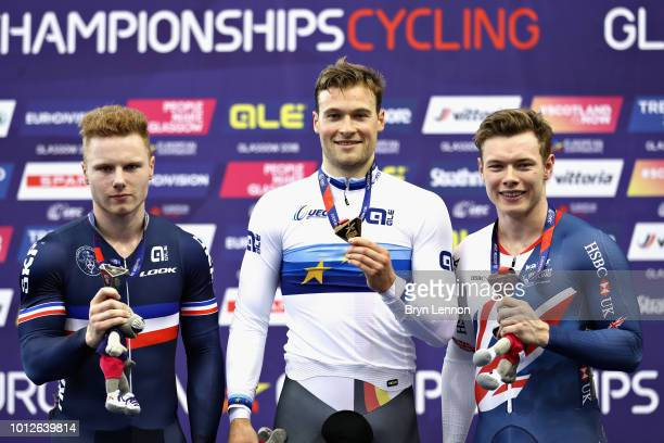 Stefan Botticher of Germany Sebastien Vigier of France and Jack Carlin of Great Britain are presented with their medals for the Men's Keirin during...