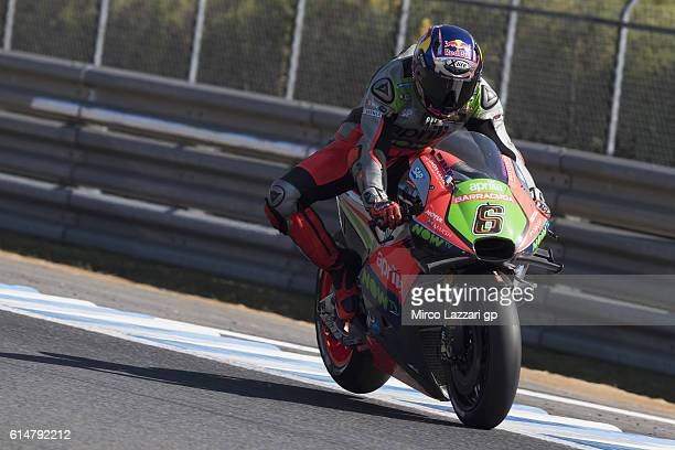 Stefan Bradl of Germany and Aprilia Racing Team Gresini lifts the rear wheel during the practice during the MotoGP of Japan Qualifying at Twin Ring...