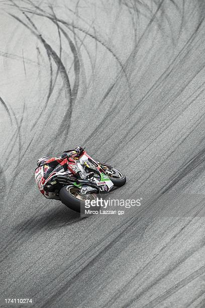 Stefan Bradl of Germany and LCR Honda MotoGP rounds the bend during the MotoGp Red Bull US Grand Prix Qualifying at Mazda Raceway Laguna Seca on July...