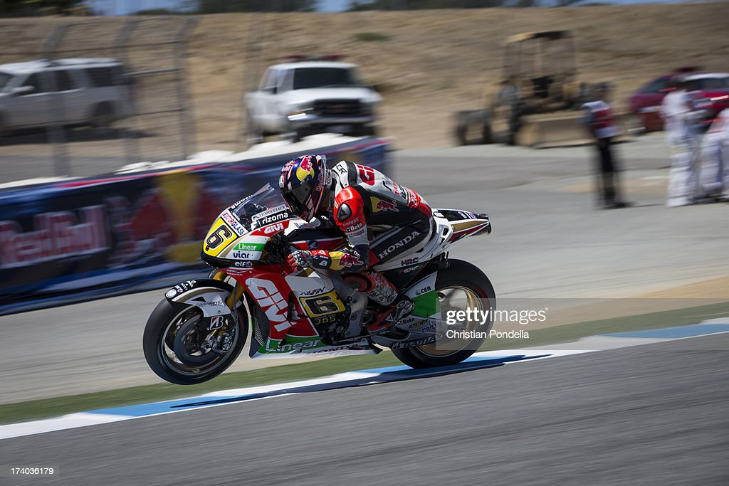 Stefan Bradl of Germany and Team LCR Honda MotoGP accelerates out of the corner at the MotoGP race of Red Bull U.S. Grand Prix at Mazda Raceway Laguna Seca on July 19, 2013 in Monterey, California.