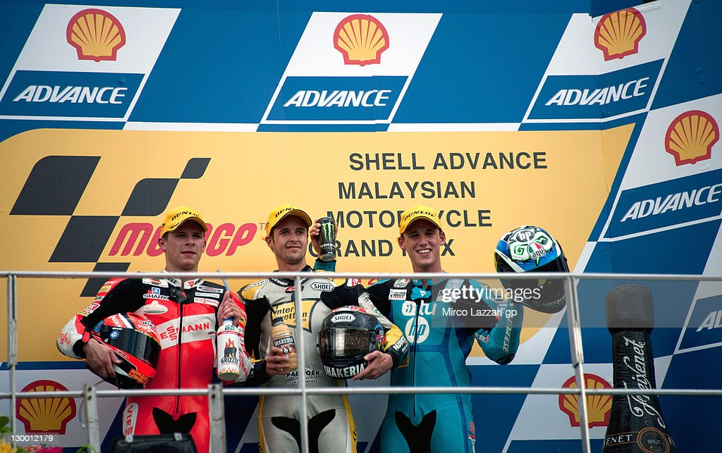 Stefan Bradl of Germany and Viessmann Kiefer Racing and Thomas Luthi of Switzerland and Interwetten Paddock and Pol Espargaro of Spain and HP Tuenti Speed Up pose the podium at the end of the Moto2 race of MotoGP of Malaysia at Sepang Circuit on October 23, 2011 in Kuala Lumpur, Malaysia.