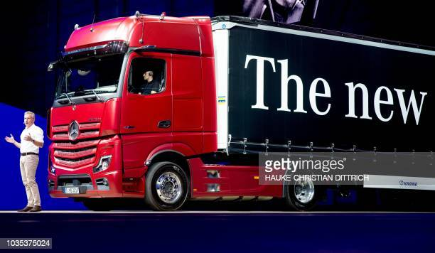 Stefan Buchner responsible for the Daimler Trucks and Buses at the board of car maker Daimler AG presents the new MercedesBenz Actros truck during a...