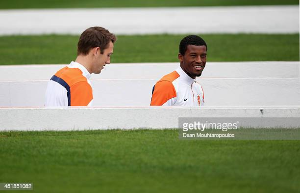 Stefan de Vrij and Georginio Wijnaldum walk out of the tunnel during the Netherlands training session at the 2014 FIFA World Cup Brazil held at the...