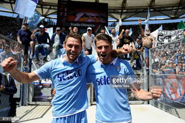 Stefan De Vrij and Wesley Hoedt of SS Lazio celebrates their victory after the Serie A match between AS Roma and SS Lazio at Stadio Olimpico on April...