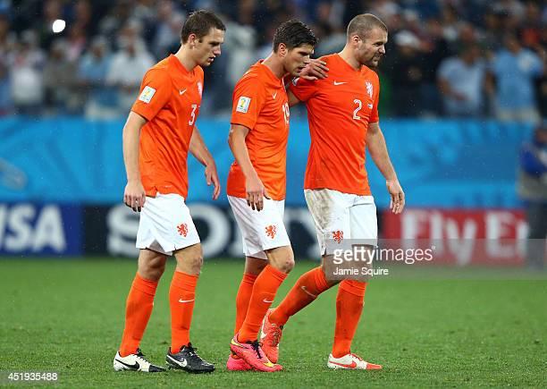 Stefan de Vrij KlaasJan Huntelaar and Ron Vlaar of the Netherlands look dejected after a defeat to Argentina in a penalty shootout during the 2014...