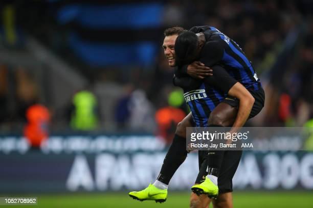 Stefan de Vrij of FC Internazionale and Keita Balde of FC Internazionale celebrate at full time during the Serie A match between FC Internazionale...