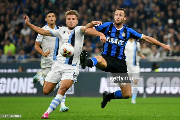 Stefan De Vrij of FC Internazionale competes for the ball with Ciro Immobile of SS Lazio during the Serie A match between FC Internazionale and SS...