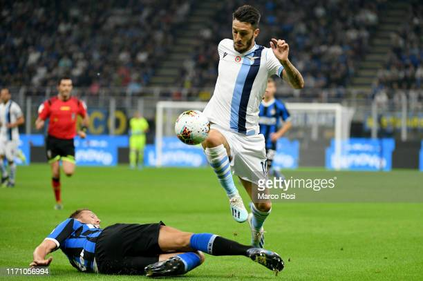 Stefan De Vrij of FC Internazionale competes for the ball with Luis Alberto of SS Lazio during the Serie A match between FC Internazionale and SS...