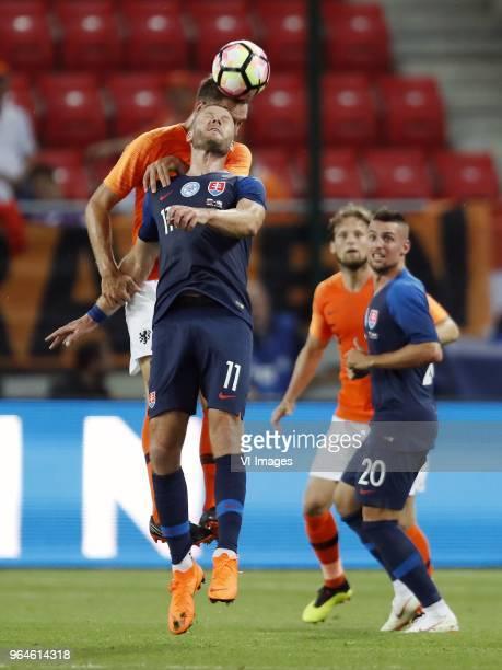 Stefan de Vrij of Holland Adam Nemec of Slovakia Daley Blind of Holland Robert Mak of Slovakia during the International friendly match between...
