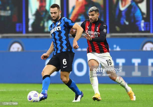 Stefan De Vrij of Internazionale competes for the ball with Theo Hernandez of AC Milan during the Serie A match between FC Internazionale and AC...
