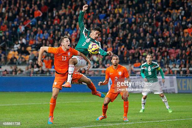 Stefan de Vrij of Netherlands and Raul Jimenez of Mexico battle for the header during the international friendly match between Netherlands and Mexico...