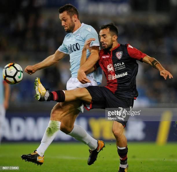 Stefan De Vrij of SS Lazio compete for the ball with Marco Sau of Cagliari Calcio during the Serie A match between SS Lazio and Cagliari Calcio at...