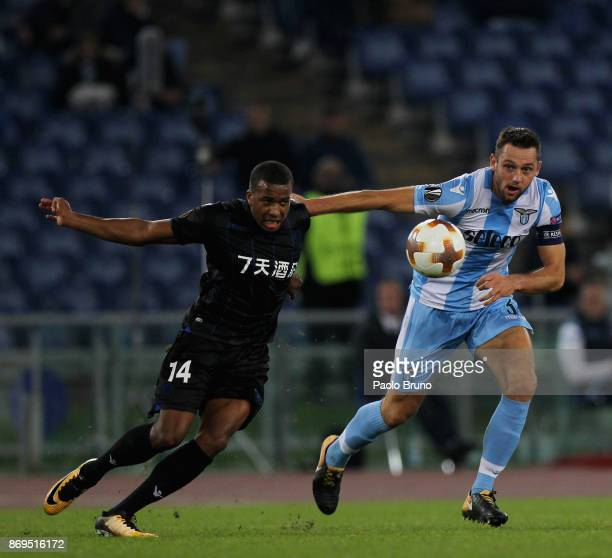 Stefan De Vrij of SS Lazio competes for the ball with Alassane Plea of OGC Nice during the UEFA Europa League group K match between SS Lazio and OGC...