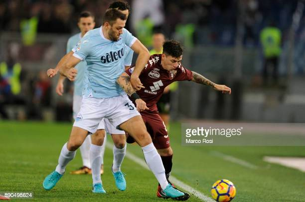 Stefan De Vrij of SS Lazio competes for the ball with Daniele Baselli of Torino FC during the Serie A match between SS Lazio and Torino FC at Stadio...