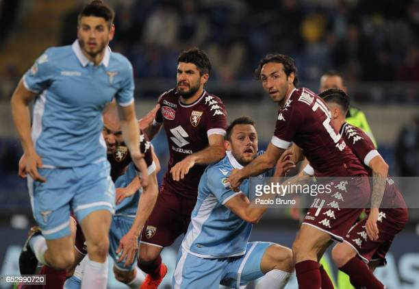 Stefan De Vrij of SS Lazio competes for the ball with Emiliano Moretti of FC Torino during the Serie A match between SS Lazio and FC Torino at Stadio...