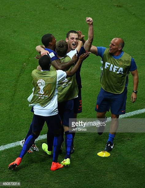 Stefan de Vrij of the Netherlands celebrates the third goal with his teammates during the 2014 FIFA World Cup Brazil Group B match between Spain and...