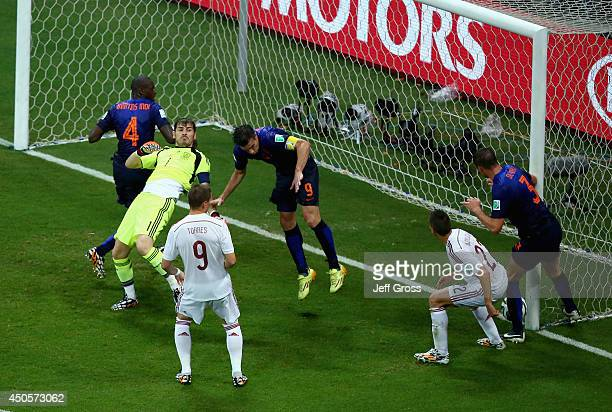Stefan de Vrij of the Netherlands deflects the ball in for the team's third goal as Iker Casillas of Spain and Robin van Persie of the Netherlands...