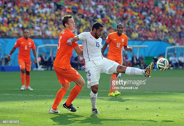 Stefan De Vrij of the Netherlands in action with Jean Beausejour of Chile during the 2014 FIFA World Cup Brazil Group B match between Netherlands and...