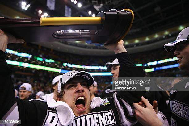 Stefan Demopoulos of the Providence Friars celebrates after the 2015 NCAA Division I Men's Hockey Championships against the Boston University...