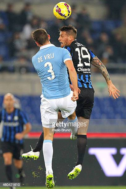 Stefan DeVrij of SS Lazio competes for the ball with German Denis of Atalanta BC during the Serie A match between SS Lazio and Atalanta BC at Stadio...