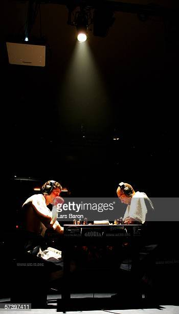 Stefan Dittrich of Germany makes a move against Jan Mielke of Germany during the Chess Boxing Cologne Championship at the Gloria Theater on April 21...