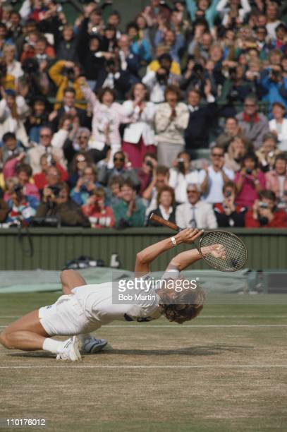 Stefan Edberg of Sweden falls to his knees in triumph to become champion after defeating Boris Becker during their Men's Singles final match at the...