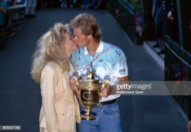 Stefan Edberg of Sweden kissing his girlfriend Annette Olsen after defeating Boris Becker of West Germany in the Men's Singles Final of the Wimbledon...
