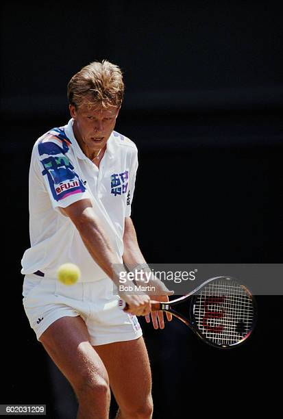 Stefan Edberg of Sweden makes a backhand return shot against Michael Stich during their Semi Final match of the Wimbledon Lawn Tennis Championship on...