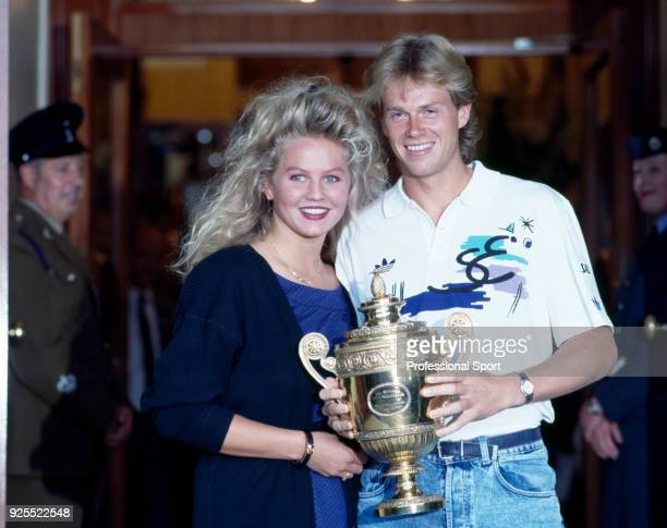 Stefan Edberg of Sweden poses with his girlfriend Annette Olsen after defeating Boris Becker of West Germany in the Men's Singles Final of the...