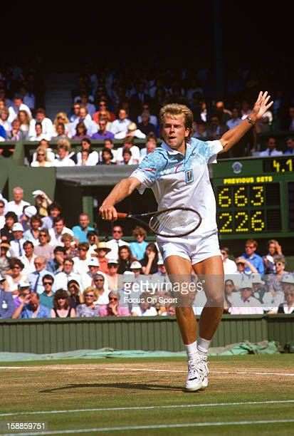 Stefan Edberg of Sweden returns a shot during the Men's singles at the Wimbledon Lawn Tennis Championships circa 1990 at the All England Lawn Tennis...