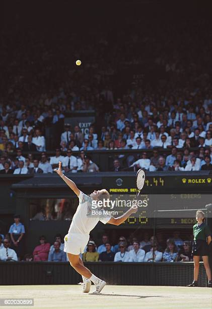 Stefan Edberg of Sweden serves to Boris Becker during the Men's Singles Final of the Wimbledon Lawn Tennis Championship on 8 July 1990 at the All...