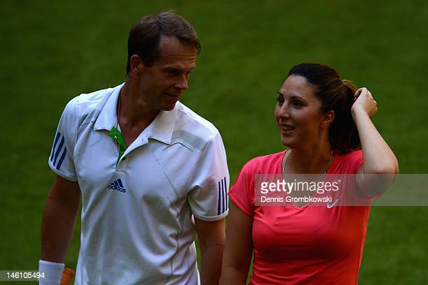 Stefan Edberg of Sweden talks to teammate Anastasia Myskina of Russia against Martina Navratilova of USA and Michael Stich of Germany during the...