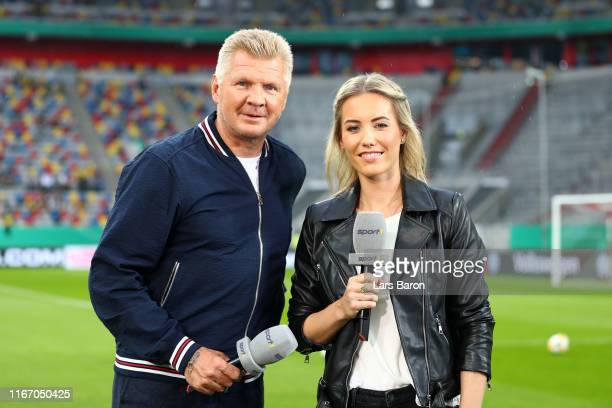 Stefan Effenberg, Former professional footballer and Laura Papendick, Sport 1 presenter pose for a picture prior the DFB Cup first round match...