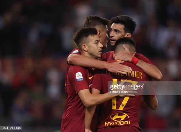 Stefan El Shaarawy of AS Roma celebrates with his teammates after scoring the team's third goal during the Serie A match between AS Roma and...