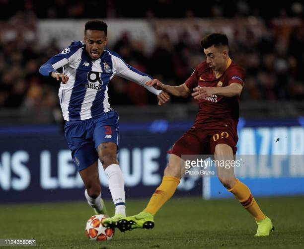 Stefan El Shaarawy of AS Roma competes for the ball with Eder Militao of FC Porto during the UEFA Champions League Round of 16 First Leg match...
