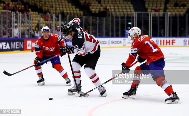 Stefan Espeland of Norway and Bo Horvat of Canada battle for the puck during the 2018 IIHF Ice Hockey World Championship Group B game between Norway...
