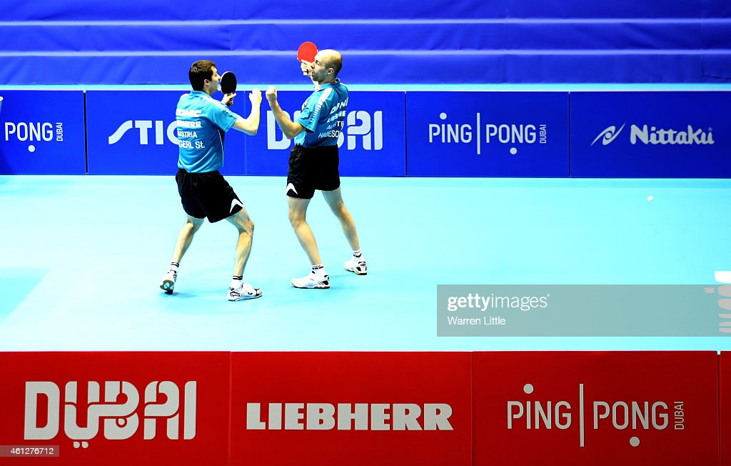 Stefan Fegerl and Daniel Habesohn celebrate beating Joao Monteiro and Tiago Apolonia of Portugal during the semi finals of the 2015 IFFT World Team Cup at the Al Nasr Stadium on January 10, 2015 in Dubai, United Arab Emirates.