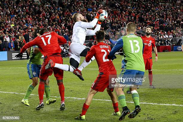 Stefan Frei of Seattle Sounders beats Jozy Altidore of Toronto FC to the ball in the second half of the MLS Cup Final on December 10 at BMO Field in...
