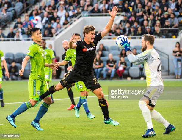Stefan Frei of Seattle Sounders catches the ball under pressure from Walker Zimmerman of Los Angeles FCduring Los Angeles FC's MLS match against...
