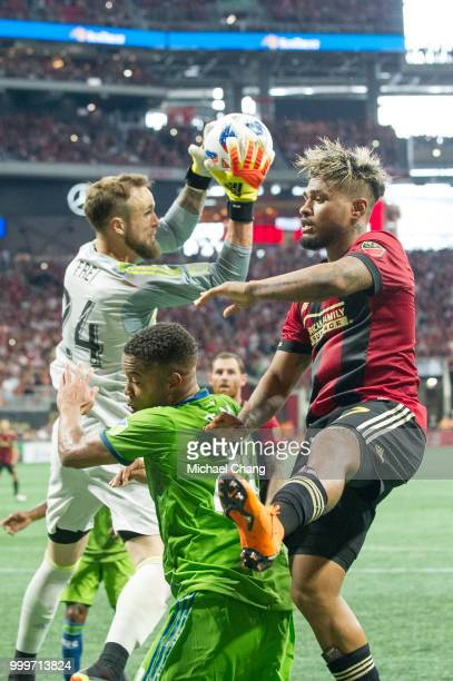 Stefan Frei of Seattle Sounders FC 2 grabs the ball in front of Josef Martinez of Atlanta United and Jordy Delem of Seattle Sounders FC 2 during the...