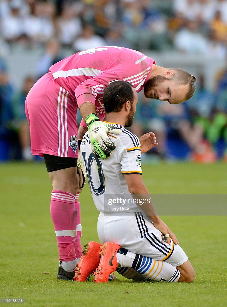Stefan Frei #24 of Seattle Sounders FC checks on Landon Donovan #10 of Los Angeles Galaxy after a collision during a 2-1 Galaxy win in the Western Conference Final at StubHub Center on November 23, 2014 in Los Angeles, California.